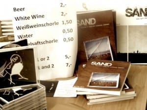 Photograph of various covers for the literary journal SAND