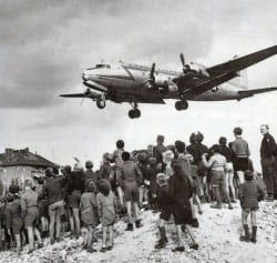 Berliners watching a C-54 land at Berlin Tempelhof Airport, 1948.