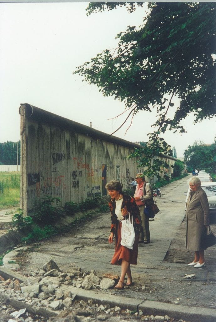 Sonja Neumann scavenging for pieces of the Wall at the corner of Heidelberger and Bouché Straße, ca. 1990. (Bouché Straße around 1989:1990.(Photo by Herbert Neumann)