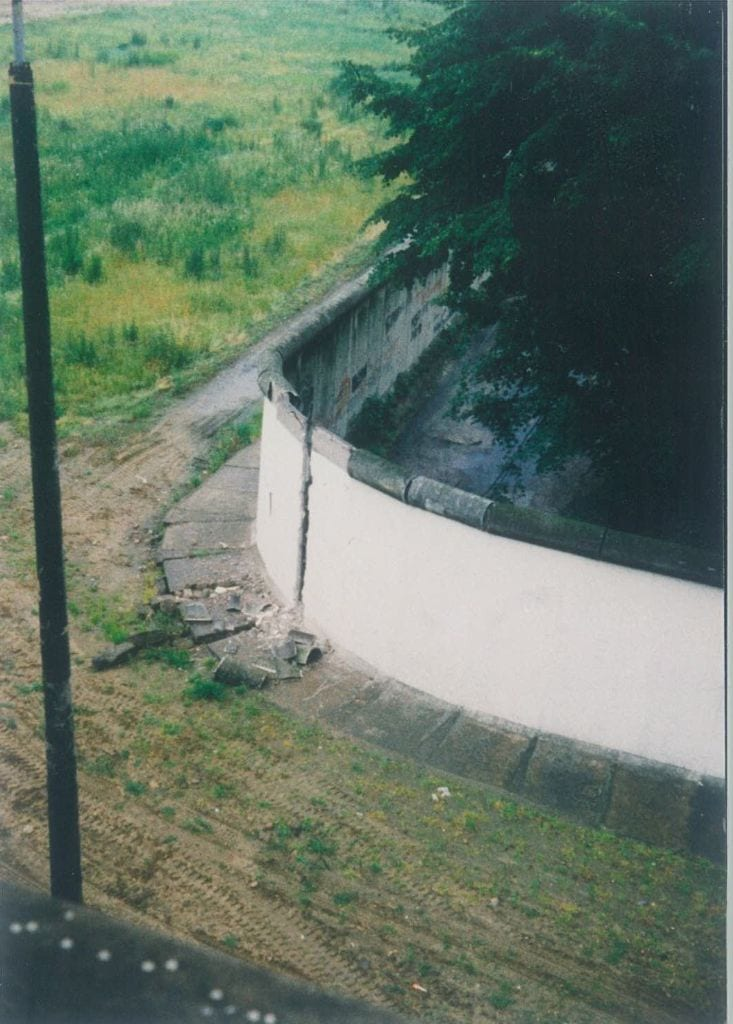Corner of Heidelberger and Bouché Straße 4 - the first tear in the Wall ca. 1989. (Photo by HN).