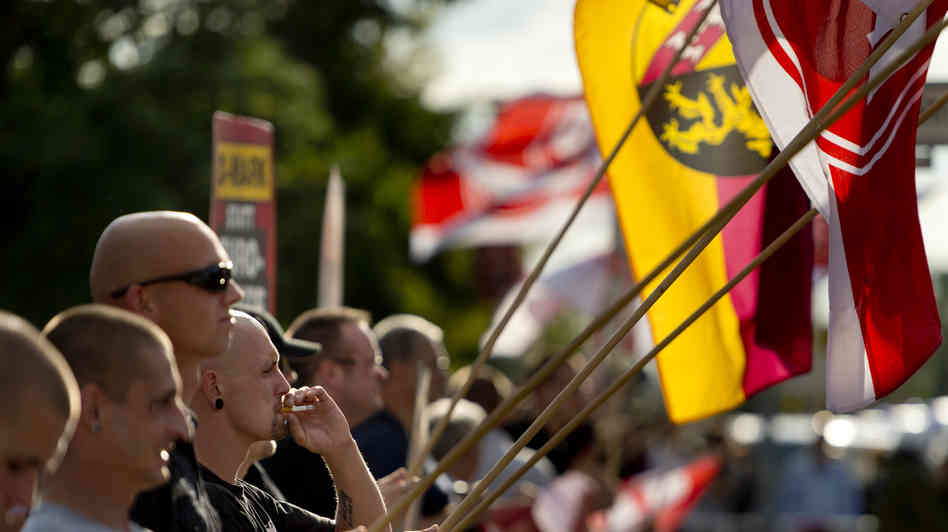 NPD Party activists hold up German flags in the Hellersdorf-Marzahn district. Image by Odd Andersen/AFP/Getty Images.